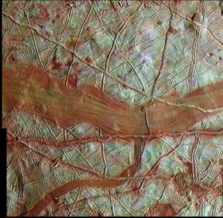 Illustration for article titled Never-Before-Seen Photo of Europa Shows Rivers of Red Ice