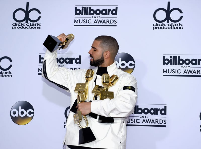 Drake poses in the press room with his many awards at the 2017 Billboard Music Awards at T-Mobile Arena on May 21, 2017, in Las Vegas.