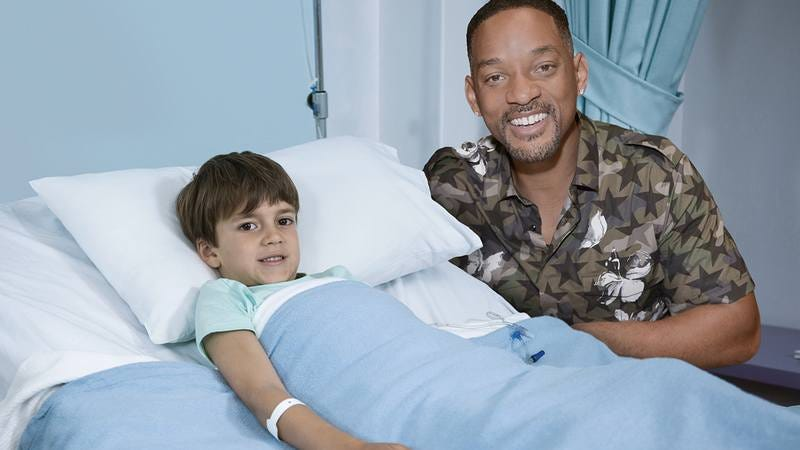 Will Smith at a child's hospital bed.