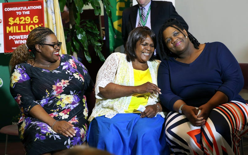 Pearlie Mae Smith, center, reacts as she sits with daughters Rene Bethina Smith and Katherine Nicole Nunnally as they talk about life after winning the lottery May 13, 2016, in Lawrenceville, N.J. (Mel Evans/AP Images)
