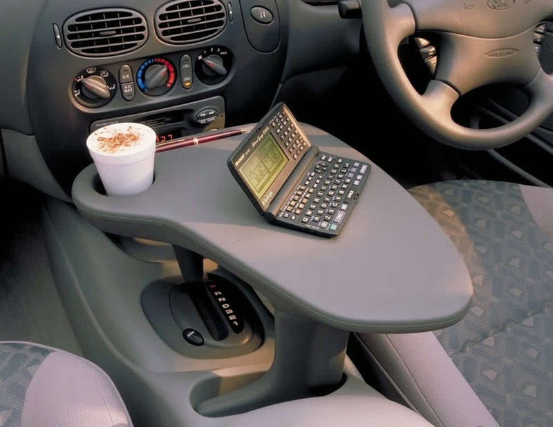 Ford Actually Offered This Shifter-Mounted Driver's Work Table In The 1990s And It's Just Amazing