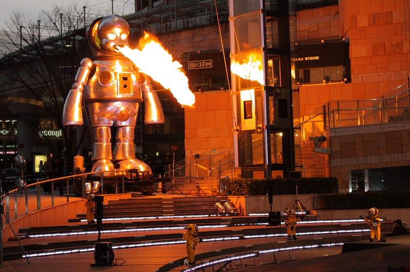 Illustration for article titled Gigantic Fire-Breathing Robot Babies Have Taken Over Roppongi