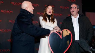 "Chairman and CEO of MacAndrews & Forbes Holdings Inc. Ron Perelman, actress Olivia Wilde and CEO of Revlon Lorenzo Delpani attend Revlon's ""Love Is On"" event Nov. 18, 2014, in Times Square in New York City.Cindy Ord/Getty Images for Revlon"