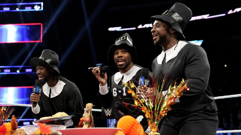 Xavier Woods (center) with fellow members of The New Day as they give thanks on Smackdown last night. They don't usually dress as pilgrims, but they did, because... wrestling.