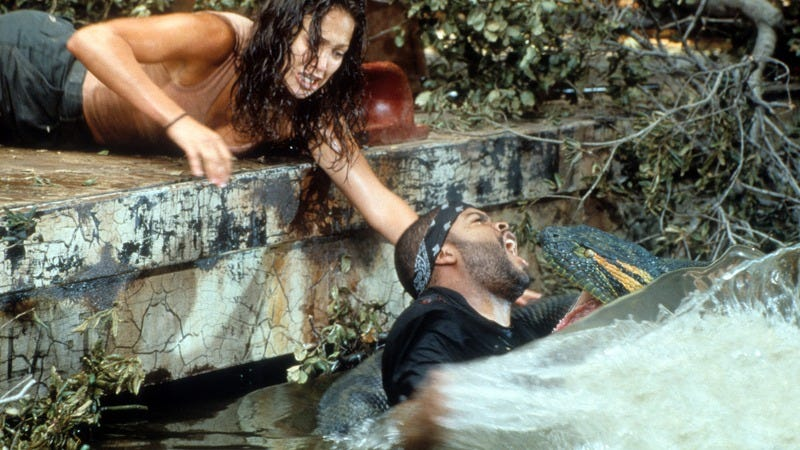 Jennifer Lopez reaching for Ice Cube as he's attacked in the 1997 film Anaconda (Photo: Columbia Pictures/Getty Images)