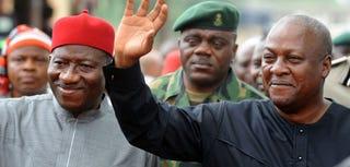 Ghanaian President John Dramani Mahama (right) waves to the crowd with Nigerian President Goodluck Jonathan. (AFP)