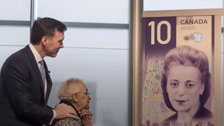 Wanda Robson, sister of Viola Desmond, unveils the new $10 bank note, featuring Desmond, with Canadian Minister of Finance Bill Morneau in Halifax, Nova Scotia, on March 8, 2018.