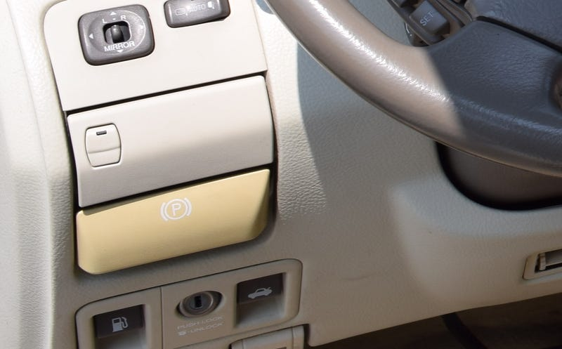 Illustration for article titled Was that parking brake release always that color?