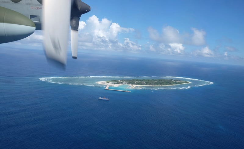 n this March 23, 2016, file photo, an aerial view is seen from a military plane carrying international journalists of the Taiwan-controlled Taiping island, also known as Itu Aba, in the Spratly archipelago, roughly 1600 kms. (1000 miles) in the South China Sea of southern Taiwan. Tensions in the South China Sea are rising, pitting China against smaller and weaker neighbors who all lay claim to a string of isles, coral reefs and lagoons, rich in fish and potential gas and oil reserves. (AP Photo/Johnson Lai, File)