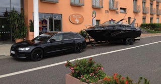 Illustration for article titled Today's Audi Color of the Day..Brilliant Black A6 Avant.....and a boat!