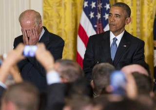 President Barack Obama and Vice President Joe Biden react to a heckler's interruption ofthe president's speechduring a LGBT Pride Month receptionin the White House June 24, 2015.SAUL LOEB/AFP/Getty Images