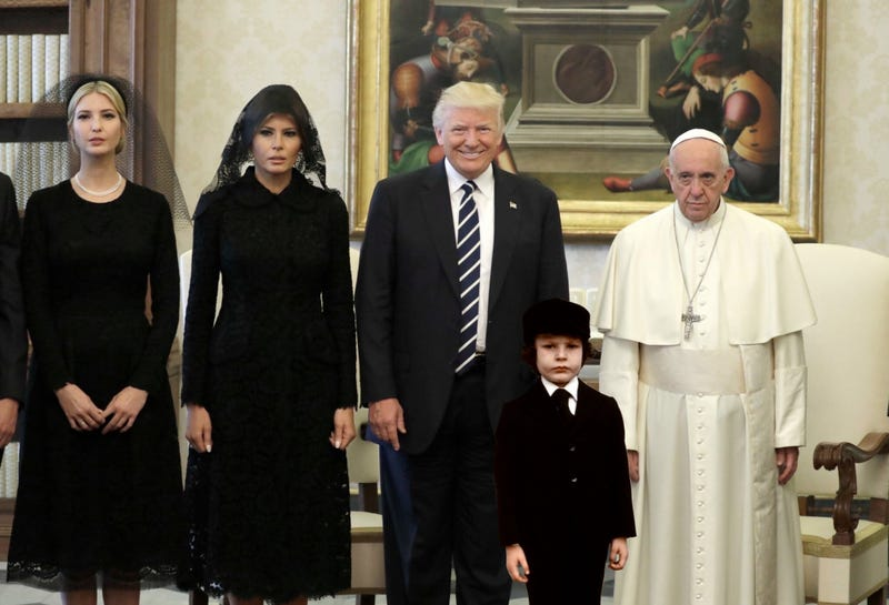 Photoshopped image that adds Damien from the 1976 horror film The Omen to a photo with President Trump, Pope Francis, Melania Trump, and Ivanka Trump (Photoshop by James White with a photo by Evan Vucci for the Associated Press)