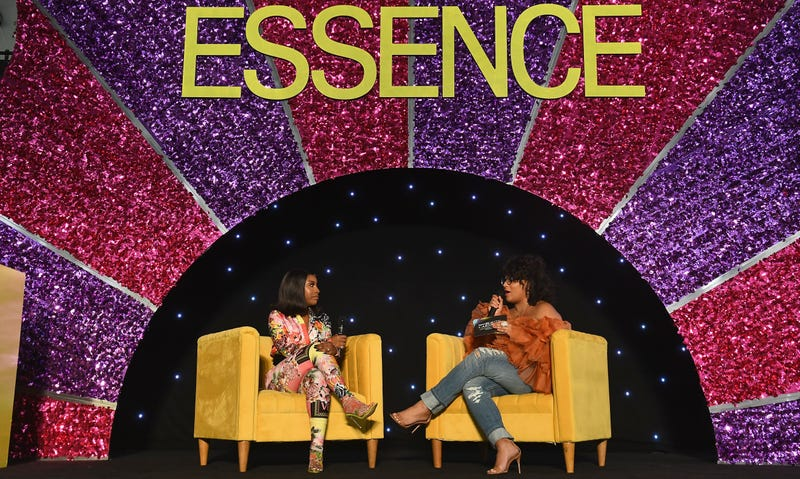 Jackie Aina and Julee Wilson speak on stage during the 2019 ESSENCE Beauty Carnival Day 2 on April 28, 2019 in New York City.