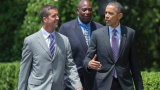 President Barack Obama (R) arrives with Baltimore Ravens Coach John Harbaugh (L) and Ravens General Manager Ozzie Newsome (C) for a ceremony at the White House in Washington, D.C., June 5, 2013JIM WATSON/AFP/Getty Images