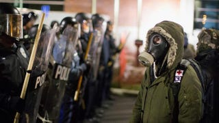 Police confront demonstrators protesting the shooting death of Michael Brown outside the police station Nov. 19, 2014, in Ferguson, Mo.Scott Olson/Getty Images