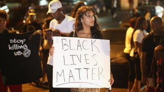 Demonstrators gather along West Florissant Avenue in Ferguson, Mo., Aug. 15, 2014, to protest the shooting death of Michael Brown.Scott Olson/Getty Images