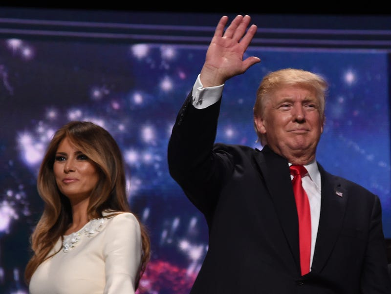 Republican presidential nominee Donald Trump, next to his wife, Melania, waves after accepting the GOP party nomination on the last day of the Republican National Convention in Cleveland on July 21, 2016.TIMOTHY A. CLARY/AFP/Getty Images