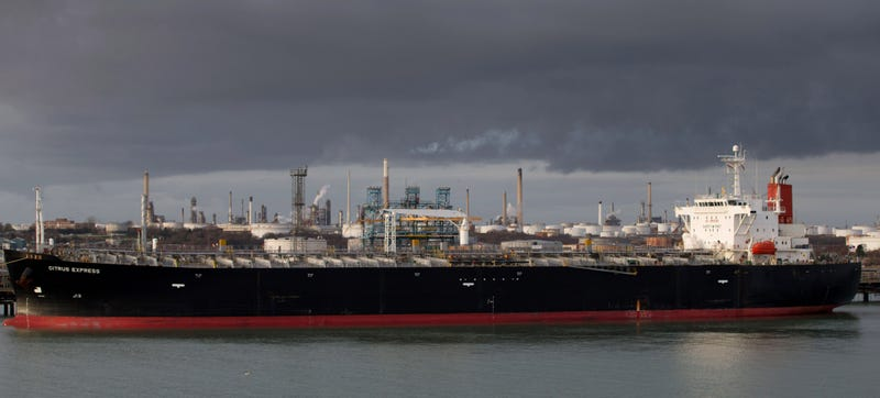 A tanker is berthed beside the Fawley oil refinery and Hamble oil terminal on January 7, 2015, in Southampton, England. Image credit: Matt Cardy/Getty Images.