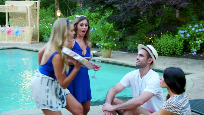 Lauren Wirkus smashes Carl Radke in the face with a Fourth of July sheet cake while he talks to other girls.