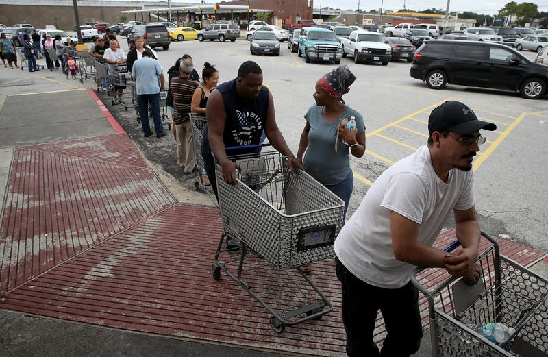 People line up to buy groceries in the Chanelview section of Houston  following Hurricane Harvey on Aug. 29, 2017. (Win McNamee/Getty Images)