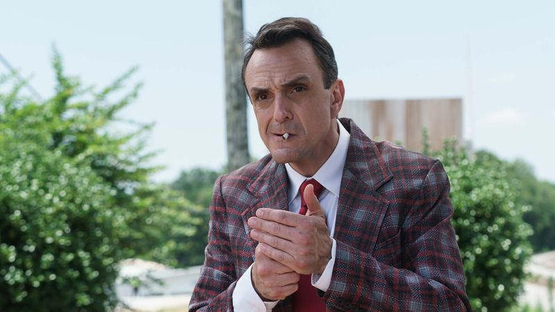 Hank Azaria smoking a cigarette (or weed)
