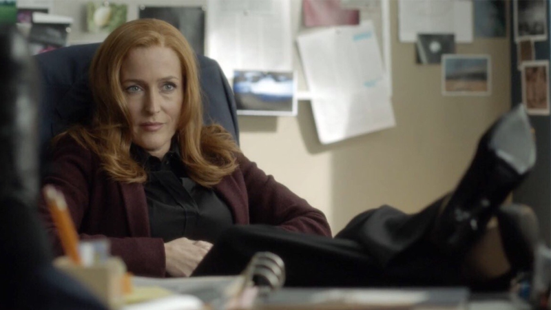 Gillian Anderson as Special Agent Dana Scully, wearing the face of a woman who is really, really done with all this.