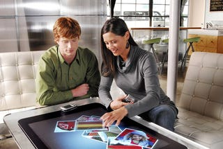 Illustration for article titled Microsoft Surface Confirmed: Touch-Sensitive, $10k, Minority Report Table