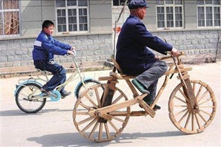 Illustration for article titled Chinese Villager Takes Wooden Bike Out For a Spin