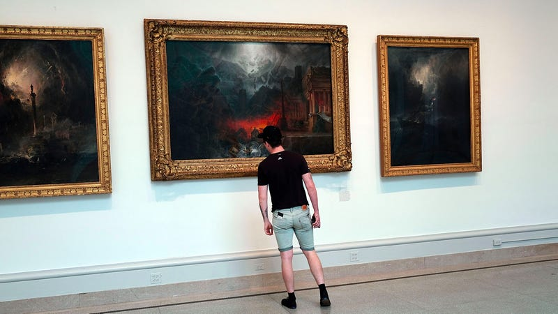 Somebody getting close, but no closer than appropriate to a painting at the Brooklyn Museum. Photo via Getty.