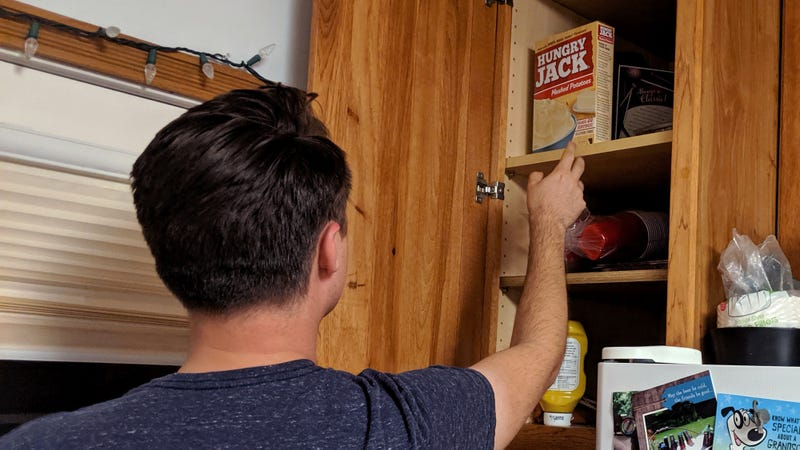 Illustration for article titled Dwindling Kitchen Resources Forcing Man To Scavenge For Food Higher And Higher In Cabinets