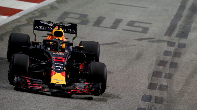 """Daniel Ricciardo passes a """"bus"""" marking on the F1 street circuit in Singapore in September of this year."""