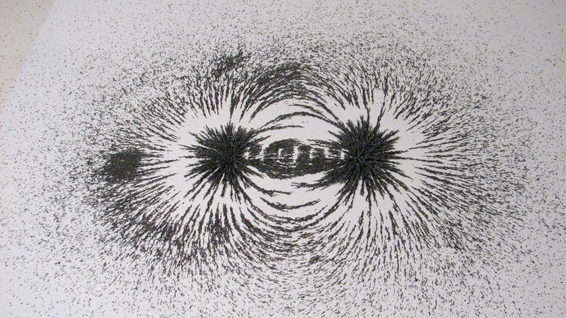 A magnetic field visualized with iron filings. This image has little to do with the experiment described in the article, except that they both require intense magnetic fields.