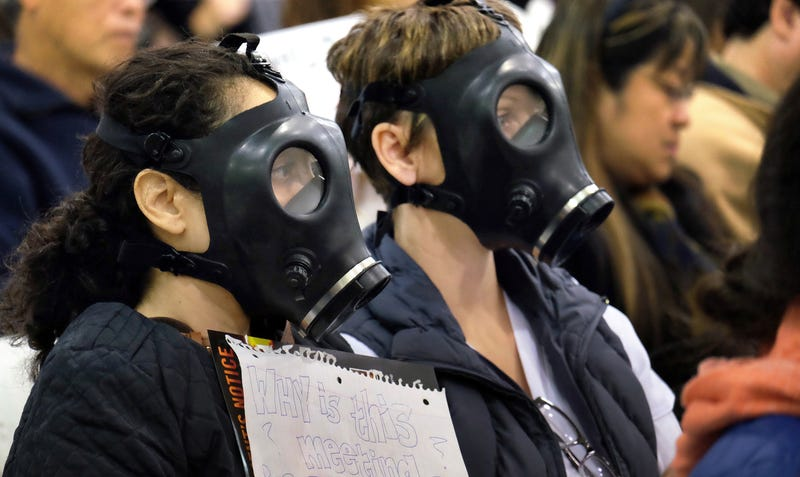 Protestors wearing gas masks attend a hearing over the Aliso Canyon gas leak on January 16th. Image Credit: Richard Vogel / AP