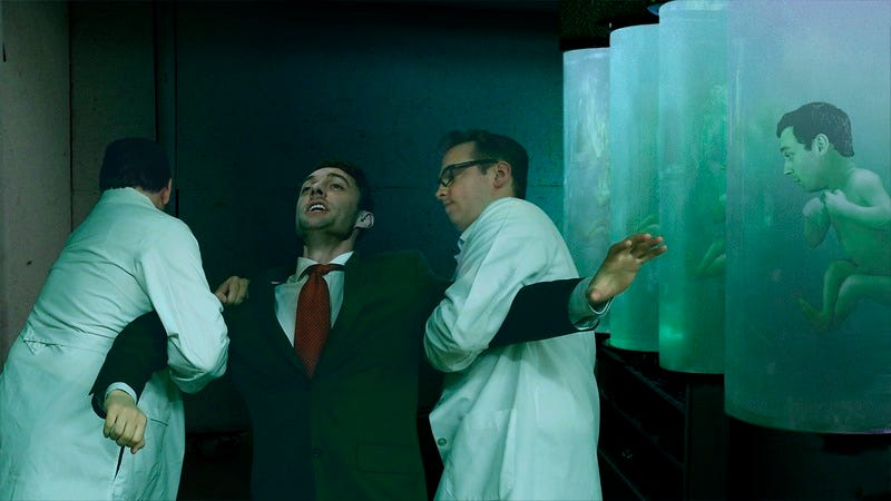 Jon Ossoff being dragged away by two scientists.