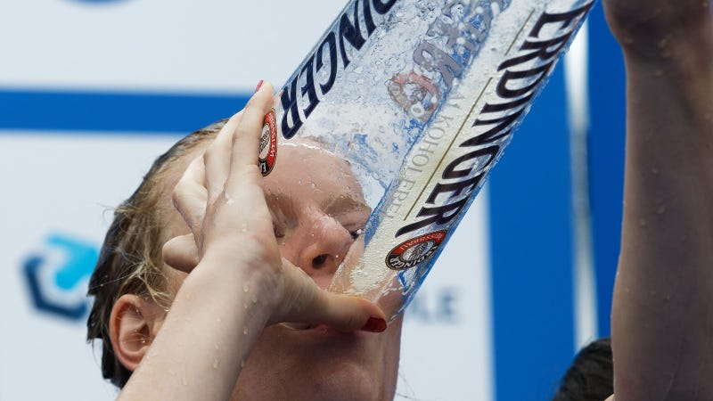 Laura Lindemann (GER) enjoys a last slip of beer from the beer shower at the podium in the Team Relay World Championship at the ITU World Triathlon Hamburg on July 17, 2016 in Hamburg, Germany. (Photo by Petko Beier/Getty Images)