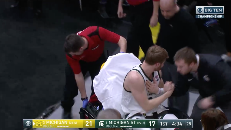 Illustration for article titled Michigan State's Kyle Ahrens Exits Big Ten Championship Game On Stretcher After Gruesome Ankle Injury [Update]