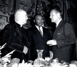 Cardinal Francis Joseph Spellman, archbishop of New York; the Rev. Martin Luther King Jr.; and New York Gov. Nelson Rockefeller at the Sheraton Hotel in New York City in 1962 for the centennial of the Emancipation Proclamation.1962 New York State Archives