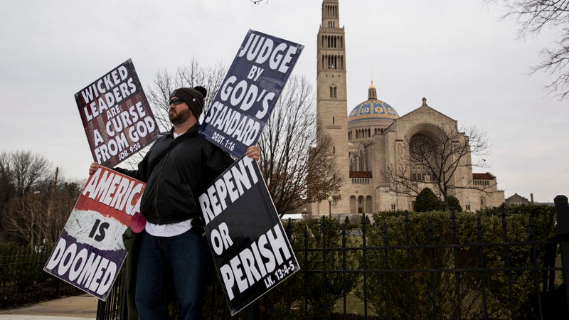 A member of the Westboro Baptist Church pickets the funeral of Antonin Scalia. Photo via Getty Images.