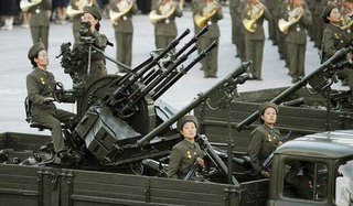 Illustration for article titled Kim Jong Un's N. Korea Prefers Mass Executions By Anti-Aircraft Cannons