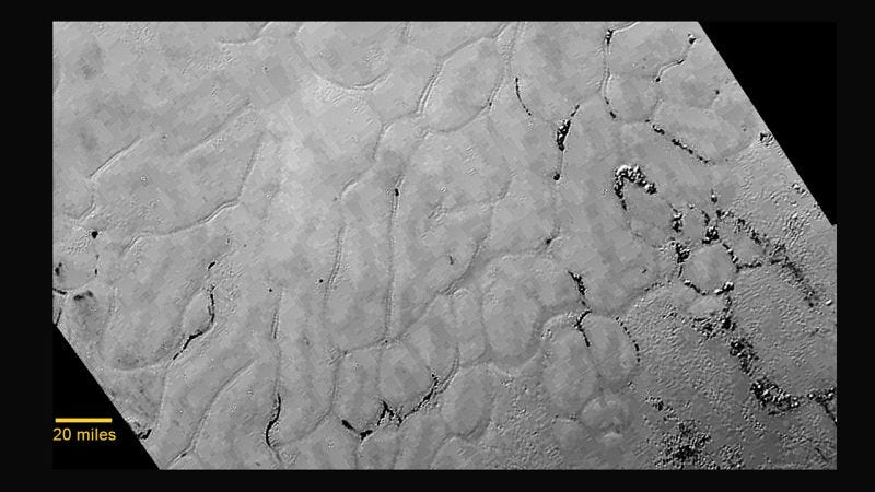 Illustration for article titled We Finally Think We Know What Caused Pluto's Weird, Bumpy Plains