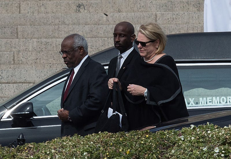 Clarence Thomas, left, and his wife, Virginia (Nicholas Kamm/AFP/Getty Images)