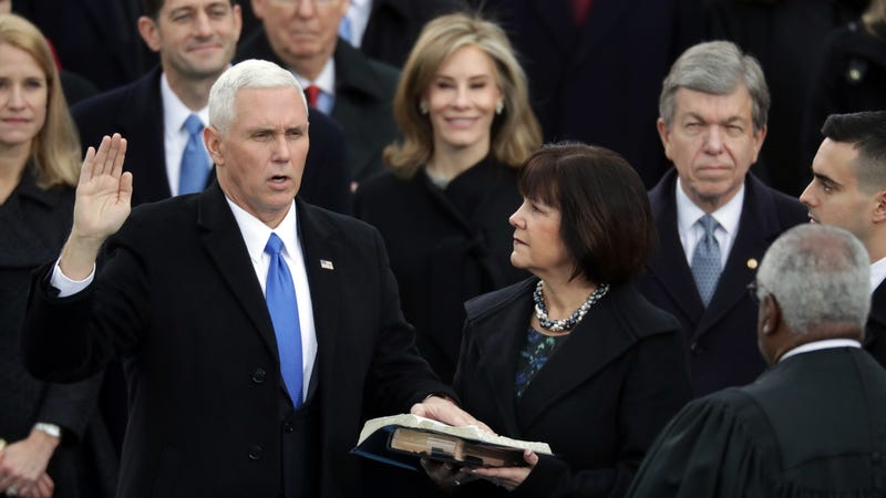 Mike Pence, shown doing what he loves best: Using the Bible to accrue political power