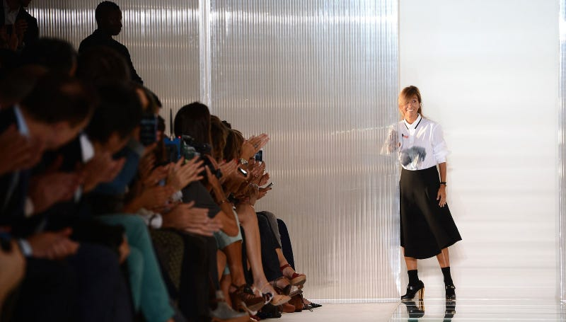 Consuelo Castiglioni takes a bow at her Spring 2013 show. All images via Getty.