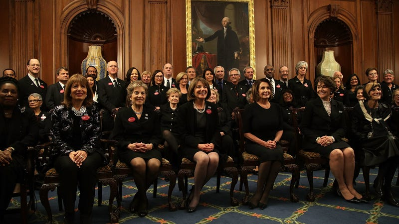 House Democrats pose in their funereal best. Photo via Getty.