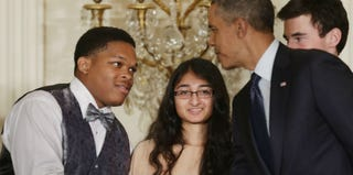 Obama congratulates Anthony Halmon (left) and other students at White House Science Fair. (Chip Somodevilla/Getty Images)