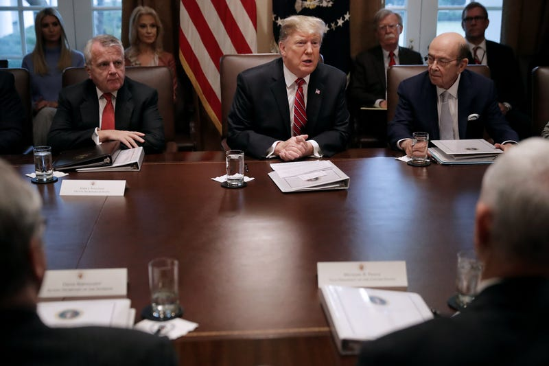 President Donald Trump (C) talks to reporters with Deputy Secretary of State John Sullivan (L) and Commerce Secretary Wilbur Ross during a meeting of his cabinet in the Cabinet Room at the White House February 12, 2019 in Washington, DC. Trump said he was not happy about the compromise legislation agreed to by Republicans and Democrats that would prevent a new partial federal government shutdown but said he would accept the deal.