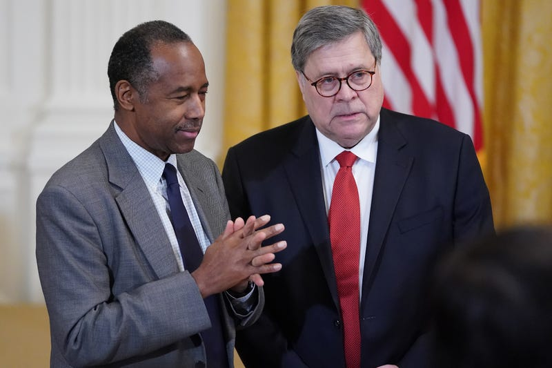 Housing and Urban Development Secretary Ben Carson (L) and Attorney General William Barr attend a First Step Act celebration in the East Room of the White House April 01, 2019 in Washington, DC.