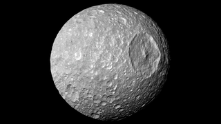 Illustration for article titled Does Saturn's 'Death Star' Moon Harbor A Hidden Ocean?