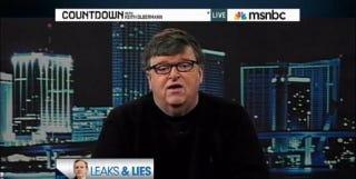 "Illustration for article titled Michael Moore Calls Assange Rape Case ""Hooey"""
