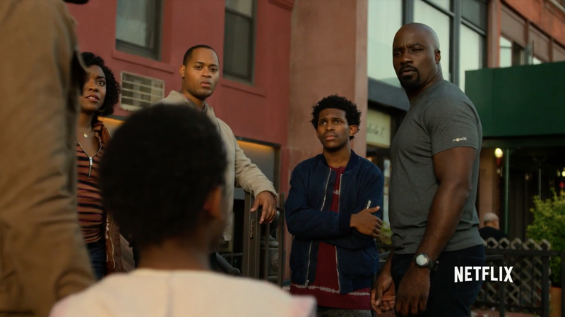 Luke Cage being confronted by a number of his neighbors.